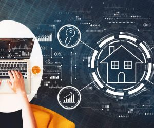 Real estate theme with person using a laptop